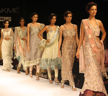 Models line the ramp at the closing of Jatin Varma's showing on Day One of the LFW