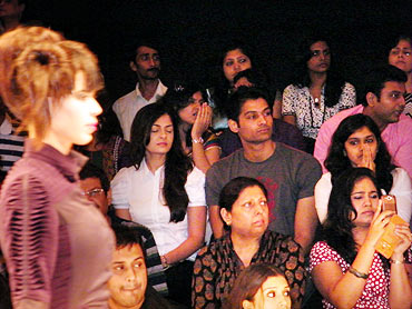 The audience takes in some ramp action at an LFW showing