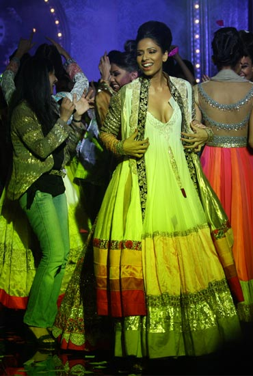 Spectators dance with the models at the close of Manish Malhotra's showing
