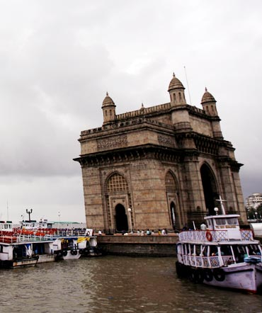 Monsoon clouds gather over the Gateway of India in Mumbai