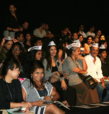 Attendees wearing 'I am Anna Hazare' caps expressed their solidarity to the anti-corruption movement at the Lakme Fashion Week in 2011