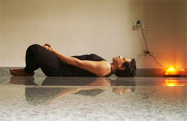 Supta baddhakonasana (Lying leg locked pose)