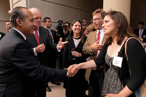 Aysha Bagchi (right) meets Mexican President Felipe Calderon (left)