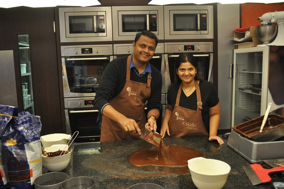 Gouri Patwardhan with her husband taking lessons in chocolate making