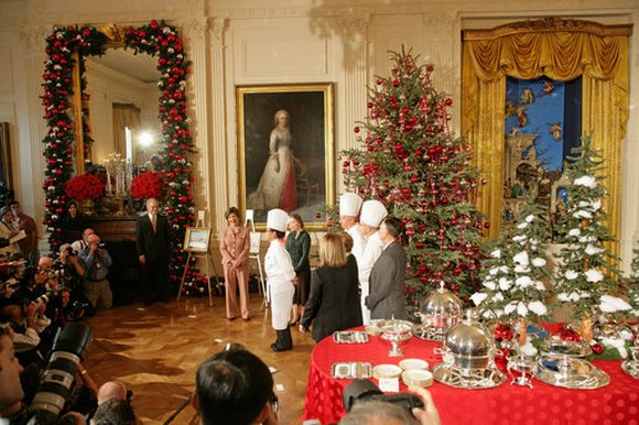 Decide on your menu well in advance so you're all set to host a grand party. Here, Laura Bush and White House Chef Cris Comerford, center, explain the holiday reception menu to the press in the State Dining Room