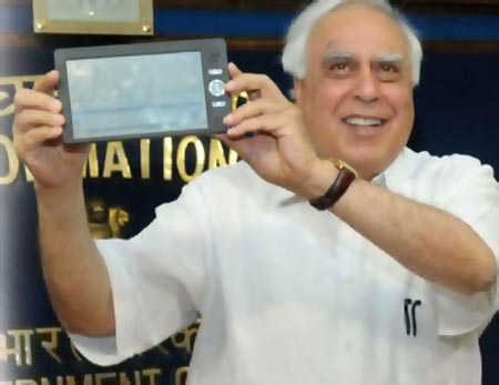 India's minister of communications and information technology Kapil Sibal unveiling Aakash