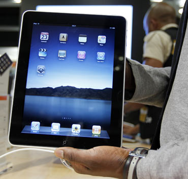 A salesman displays an Apple iPad during its launch in Brussels July 23, 2010