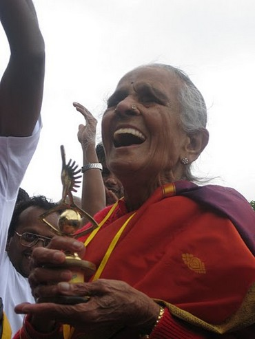 One of the senior participants at the Women Power 5K Run in Bengaluru celebrates at the finish line
