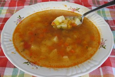 Begin dinner with a clear soup containing vegetables