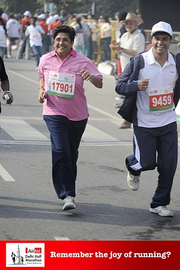 Ferose participating in a marathon along with social activist Kiran Bedi