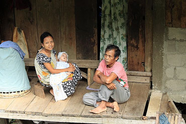 Khasi couple with their new born baby.