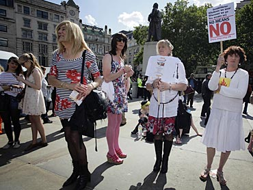 People attend a rally in Trafalgar Square during SlutWalk in London June 11, 2011