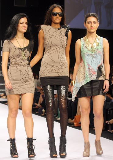 Anna-Liza Ganguly and Anita Walia with Surelee Joseph (centre) in one of their deux A designs