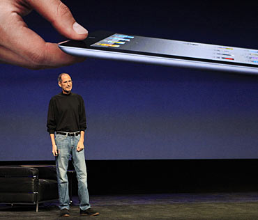 Apple Inc. CEO Steve Jobs introduces the iPad 2 on stage during an Apple event in San Francisco, California March 2, 2011.  Jobs took the stage to a standing ovation on Wednesday, returning to the spotlight after a brief medical absence to unveil the second version of the iPad