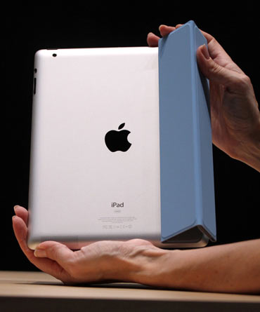 The iPad 2 with a Smart Cover is shown in use in the demonstration area after the iPad 2 launch during an Apple event in San Francisco, California March 2, 2011. Apple unveiled its next generation iPad at an event in San Francisco. Apple CEO Steve Jobs, who is on indefinite medical leave, led the event.