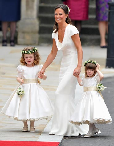 Maid of honour Pippa Middleton holds hands with bridesmaids Grace Van Cutsem and Eliza Lopes as they arrive to attend the Royal Wedding of Prince William to Catherine Middleton at Westminster Abbey on April 29, 2011 in London, England