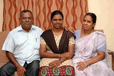 S Divyadarshini with her father and mother