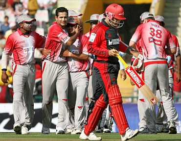 Irfan Pathan celebrating with his teammates from King's XI Punjab