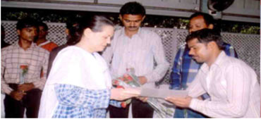 Congress President Sonia Gandhi with workers trained by Pipal Tree