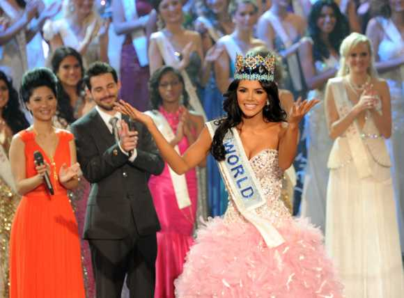 Miss Venezuela, Ivian Sarcos, reacts after being crowned Miss World 2011 in Earls Court in west London.
