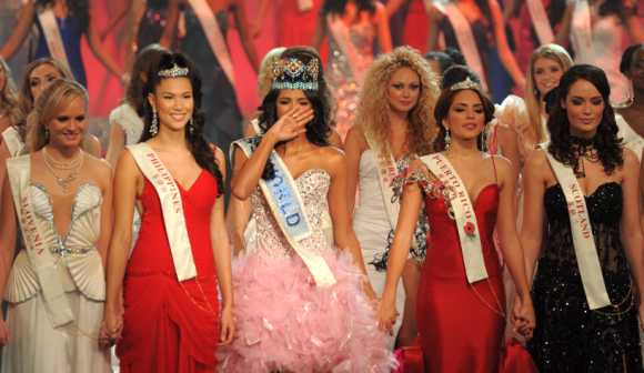 Miss Venezuela, Ivian Sarcos, joins other contestants on stage after being crowned Miss World 2011 in Earls Court in west London