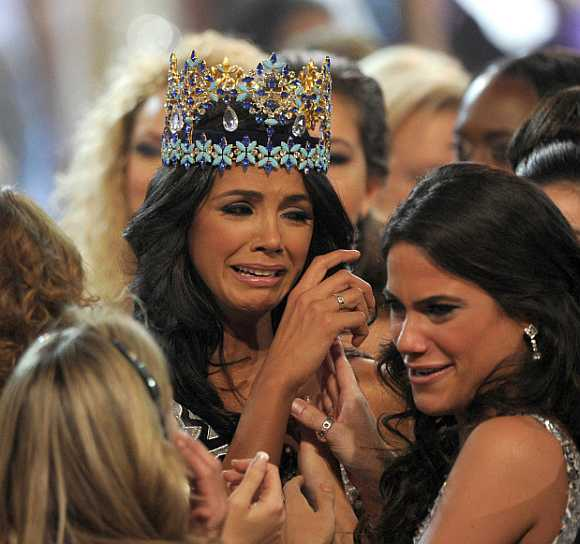 Miss Venezuela, Ivian Sarcos, is congratulated by other contestants after being crowned Miss World 2011 in Earls Court in Earls Court in west London.
