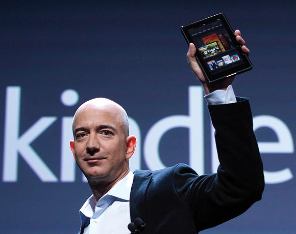 Jeff Bezos with Kindle.