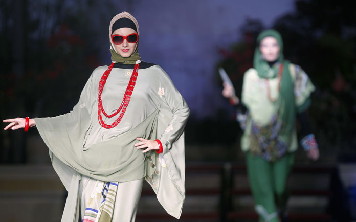 Models present creations from 'The Forbidden City' collection by Zizi Design of Malaysia