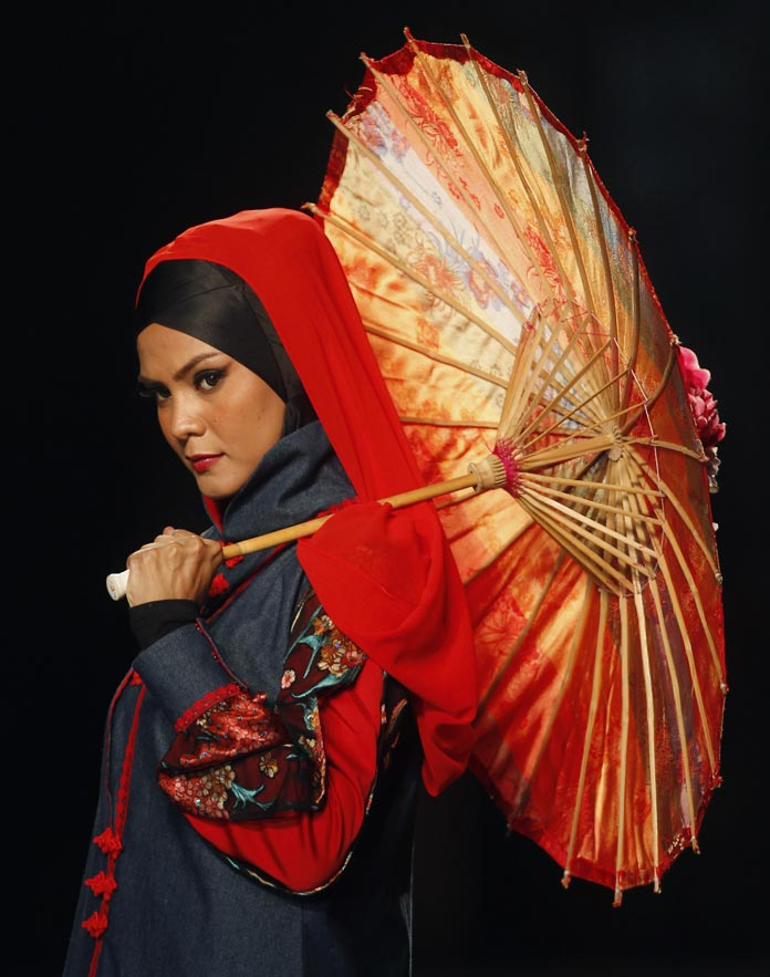 A model presents a creation from the 'Shades of Qipao' collection by Hajaba of Malaysia