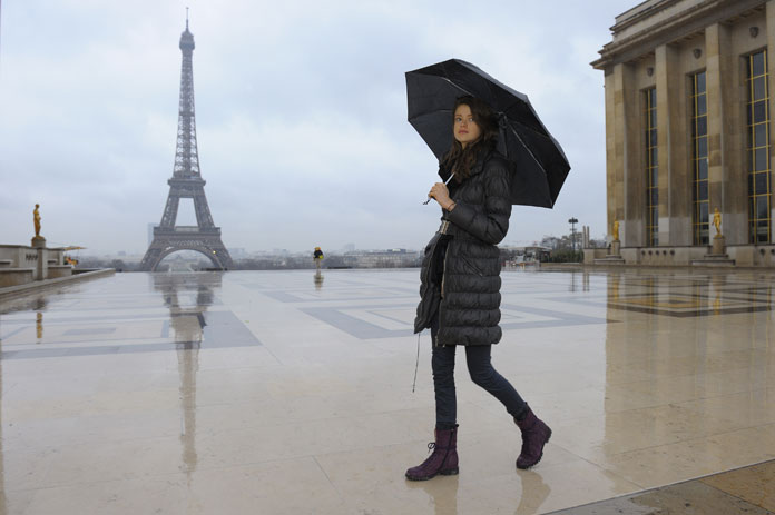 Swiss model Julia Saner walks near the Eiffel tower as she arrives for a fashion show.