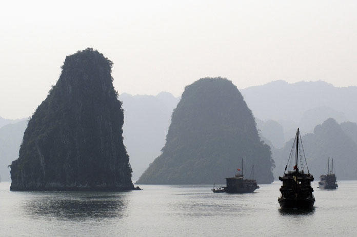 Tourist boats cruise in  Vietnam's scenic Halong Bay.