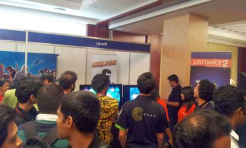 College students checking out a gaming console at Nasscom GDC 2011