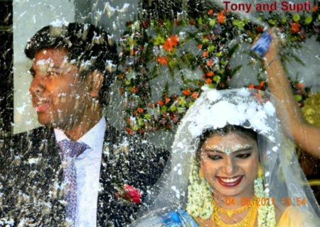 Tony Murmu on his wedding day with his wife