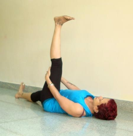 Supta hasta padasana (Lying hand to leg pose)
