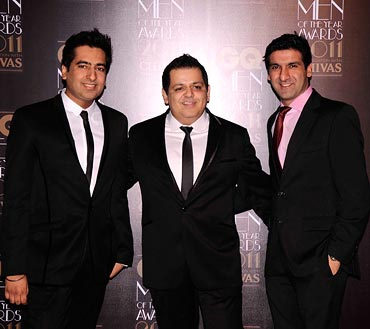 Rohit Gandhi and Rahul Khanna with an unidentified guest at the GQ Awards