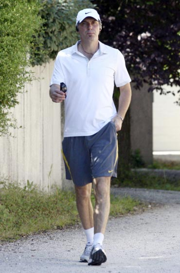 France's national soccer team coach Laurent Blanc steps out of his house for a walk