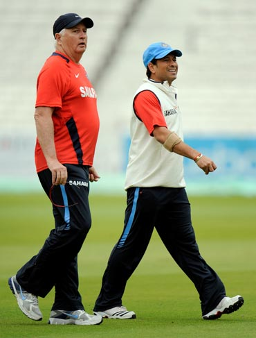 Sachin Tendulkar  walks with coach Duncan Fletcher
