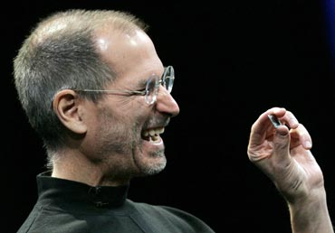 Apple CEO Steve Jobs shows the new Intel