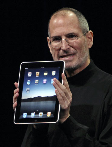 Apple Chief Executive Officer Steve Jobs holds the new  iPad during the launch of Apple's new tablet computing device in San Francisco, California, January 27, 2010.