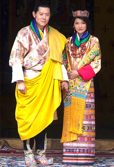 King Jigme Khesar Namgyel Wangchuck and Queen Jetsun Pema pose for pictures after their marriage at the Punkaha Dzong in Bhutan's ancient capital Punakha on October 13, 2011