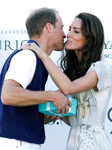 Prince William, Duke of Cambridge receives a kiss from Catherine, Duchess of Cambridge after Prince William's team won their round robin tournament at the Santa Barbara Racquet and Polo Club for a Foundation Polo Challenge that benefits the American Friends of the Foundation of Prince William and Prince Harry on July 9, 2011 in Santa Barbara, California