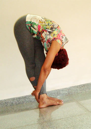 Padahastasana ( Standing forward bend, Advanced)