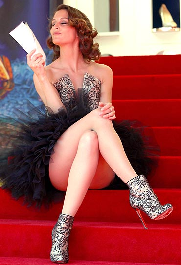 A model wears high heals designed by Christian Louboutin at 'Le Carrosse Noir And The Loubi's Angels' presented by Christian Louboutin at Palm Beach Casino during the 63rd Annual Cannes Film Festival on May 17, 2010 in Cannes, France
