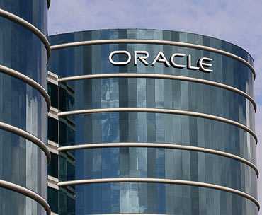 The Oracle logo is displayed on the company's headquarters in Redwood Shores, California.
