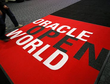 Attendees walk past a carpet at the 2011 OpenWorld Conference on October 2, 2011 at the Moscone Center in San Francisco, California. The Oracle OpenWorld Conference, the largest of its kind, will continue through October 6.