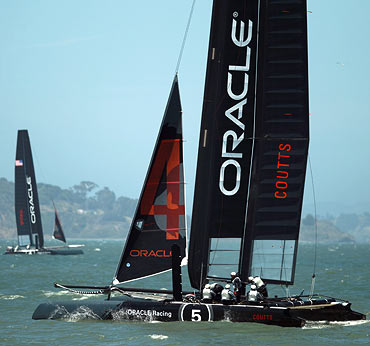 A pair of Oracle Racing AC45's skippered by Russell Coutts, right, and James Spithill, left,  train in San Francisco on Monday, June 14, 2011. The AC45 is the forerunner to the AC72, which teams will race in the Louis Vuitton Cup and America's Cup finals in 2013 in San Francisco. The AC45 will be featured at the America's Cup World Series beginning this summer in Cascais, Portugal.