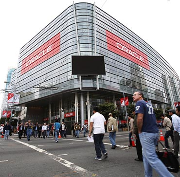 Attendees walks outside Moscone Center during the annual Oracle OpenWorld Conference on October 2, 2011 in San Francisco, California. The Oracle OpenWorld Conference, the largest of its kind, will continue through October 6.
