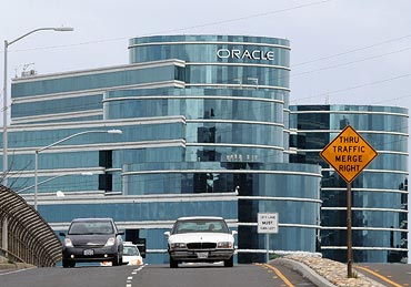 Cars drive by Oracle headquarters on March 25, 2011 in Redwood Shores, California.  Oracle reported a third quarter profit increase of 78 percent to $2.1 billion.
