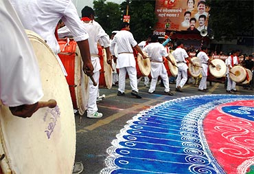 Traditional musicians play dhols en route to Kasba ganpati's immersion