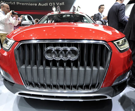 Members of the media get a close-up view of the Audi Q3 Vail during the first press preview day for the North American International Auto Show in Detroit, Michigan, January 9, 2012.